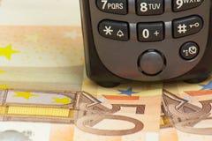 Teléfono con el dinero Fotos de archivo