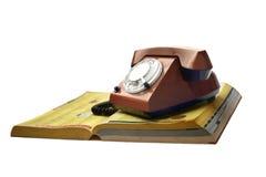 Teléfono con la guía telefónica Imagen de archivo libre de regalías