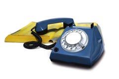 Teléfono con la guía telefónica Foto de archivo libre de regalías