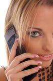 Teléfono de la cámara de la muchacha del encanto Foto de archivo libre de regalías