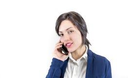 Teléfono de la mujer joven en el fondo blanco Imágenes de archivo libres de regalías