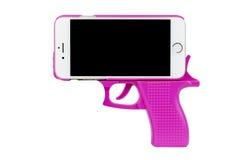Teléfono de la pistola Fotos de archivo libres de regalías