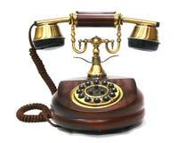 Teléfono de madera del vintage y de cobre amarillo antiguo Fotografía de archivo libre de regalías
