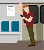 Teléfono de observación del hombre en tren del metro Foto de archivo