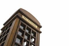 Teléfono de paga inglés de la ciudad en la ejecución del recuerdo Foto de archivo