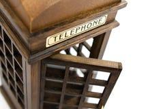 Teléfono de paga inglés de la ciudad en la ejecución del recuerdo Fotos de archivo