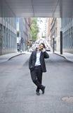 Teléfono de Smiling On The del hombre de negocios Fotografía de archivo libre de regalías