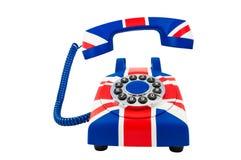Teléfono de Union Jack con el microteléfono flotante con el modelo de la bandera de Gran Bretaña aislado en el fondo blanco Imagen de archivo