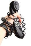 Teléfono del asimiento de la mano. Llamada, aislada. desconexión imagenes de archivo