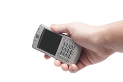 Teléfono elegante con el teclado qwerty a disposición Fotografía de archivo libre de regalías