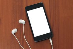 Teléfono elegante con los auriculares Imagenes de archivo