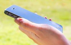 Teléfono elegante del control de la mano Fotografía de archivo libre de regalías