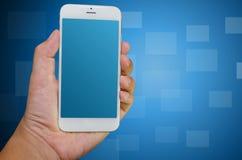 Teléfono elegante del control de la mano Fotos de archivo libres de regalías