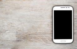 Teléfono elegante en el fondo de madera Imágenes de archivo libres de regalías
