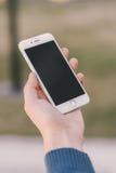 Teléfono elegante que es sostenido disponible Fotografía de archivo libre de regalías