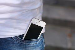 Teléfono en cierre del bolsillo de los vaqueros para arriba Fotos de archivo libres de regalías
