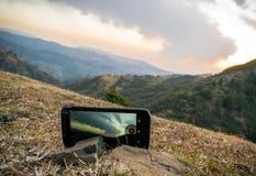 Teléfono en montañas Fotos de archivo libres de regalías