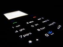 Teléfono en obscuridad imágenes de archivo libres de regalías