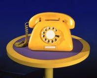 Teléfono falso amarillo del vintage imágenes de archivo libres de regalías