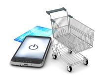 Teléfono móvil, carro de la compra y tarjeta de crédito Imagenes de archivo