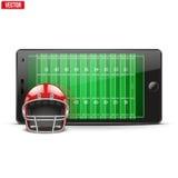 Teléfono móvil con el casco de fútbol americano y campo en Imagen de archivo