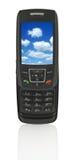Teléfono móvil con el cielo Fotos de archivo libres de regalías