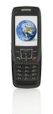 Teléfono móvil con el globo Imagen de archivo