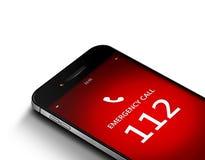 Teléfono móvil con la emergencia número 112 sobre blanco Imagen de archivo