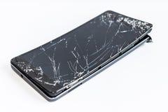 Teléfono móvil con la pantalla quebrada Fotografía de archivo
