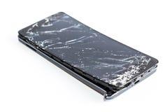 Teléfono móvil con la pantalla quebrada Foto de archivo libre de regalías