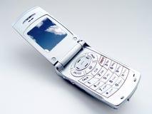 Teléfono móvil con las nubes fotografía de archivo libre de regalías