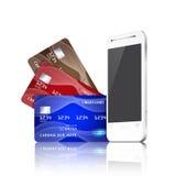 Teléfono móvil con las tarjetas de crédito. Concepto del pago. Foto de archivo libre de regalías