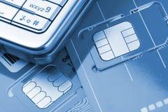 Teléfono móvil con las tarjetas del sim Fotografía de archivo libre de regalías
