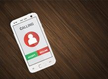 Teléfono móvil con llamada entrante Fotografía de archivo libre de regalías