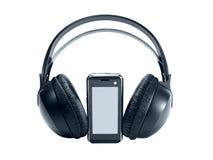 Teléfono móvil de la tecnología con los auriculares imagen de archivo libre de regalías