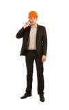 Teléfono móvil de Talking Client Through del ingeniero joven Fotografía de archivo