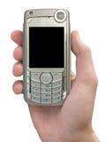 Teléfono móvil a disposición Foto de archivo libre de regalías