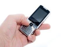 Teléfono móvil a disposición Imagenes de archivo