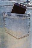 Teléfono móvil en bolsillo Foto de archivo