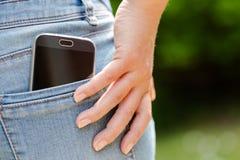 Teléfono móvil en bolsillo Imagen de archivo libre de regalías
