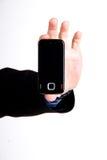 Teléfono móvil en la mano aislada en blanco foto de archivo