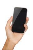 Teléfono móvil en la mano con el copyspace Fotos de archivo libres de regalías