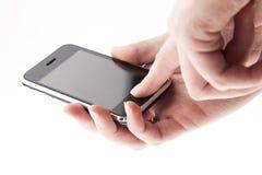 Teléfono móvil en las manos Foto de archivo libre de regalías