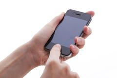 Teléfono móvil en las manos Fotos de archivo libres de regalías