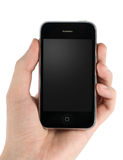 Teléfono móvil en mano del hombre Imágenes de archivo libres de regalías