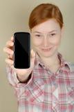 Teléfono móvil en su mano Fotos de archivo libres de regalías