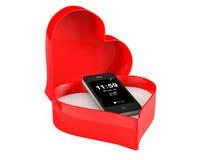 Teléfono móvil en una caja de la tarjeta del día de San Valentín del corazón Imágenes de archivo libres de regalías