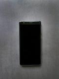 Teléfono móvil negro Imágenes de archivo libres de regalías