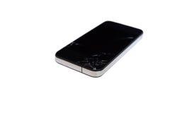 Teléfono móvil negro con una pantalla quebrada imagen de archivo