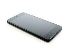 Teléfono móvil negro en blanco Fotografía de archivo libre de regalías